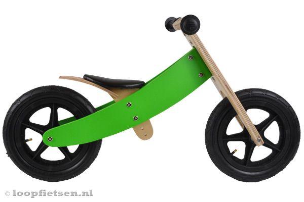 Groene loopfiets met dikke banden