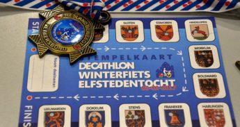 Stempelkaart-en-medaille-winterfietselfstedentocht